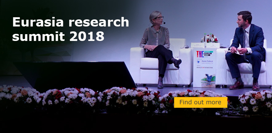 Susan Robertson answers questions on the couch at the Eurasia research summit 2018