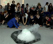 primary school children around a bubling experiment