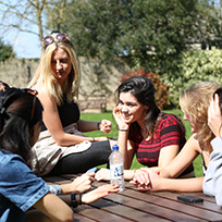 Prospective students talking in Faculty garden