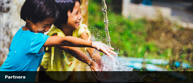 Two children playing with water PEDAL