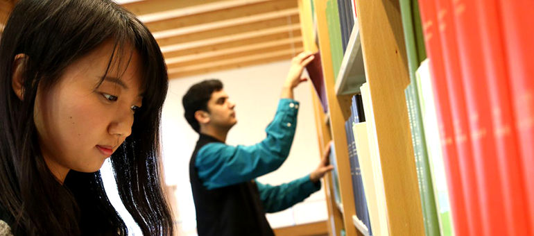 Male and female students in Library