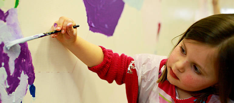 Nursery school girl painting