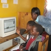 African students using a desktop computer