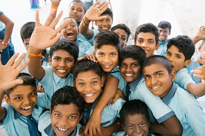 India children waving and laughing