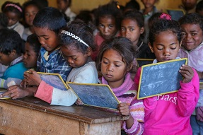 Children writing on small blackboards Madagascar