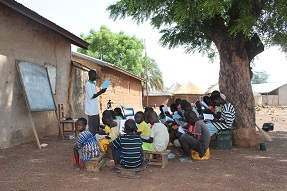 outdoor classroom under a tree Ghana