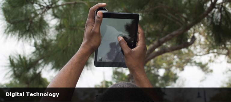 african man holding a computer tablet