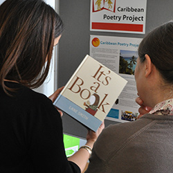 students looking at children's book