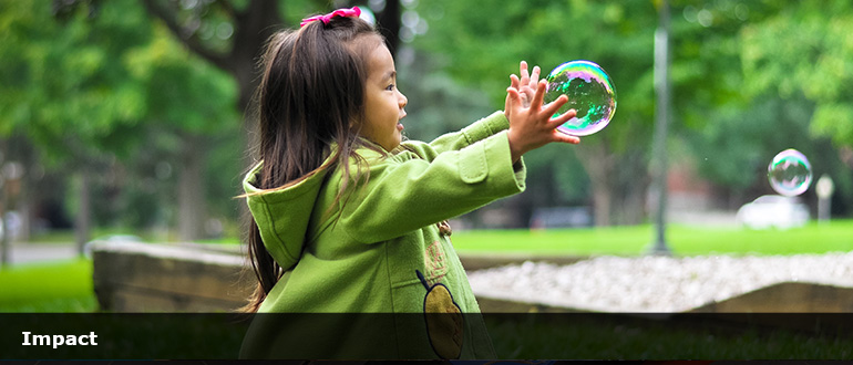 Primary school girl reaching for bubble
